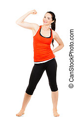 Fit sporty woman flexing muscles - A fit beautiful sporty...
