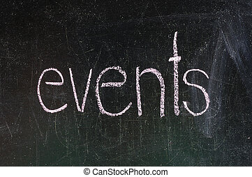 Events handwritten with white chalk on a blackboard
