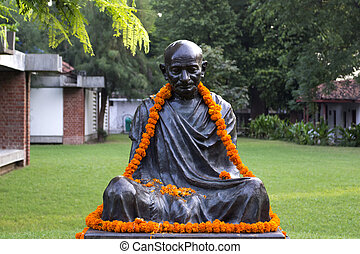 Decorated statue of Mahatma Gandhi - Flower decorated statue...