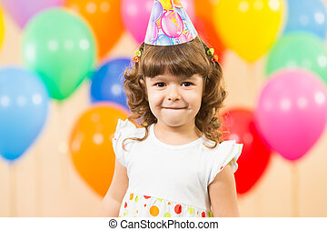 joyful kid girl on birthday party