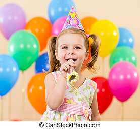 pretty joyful kid girl on birthday party