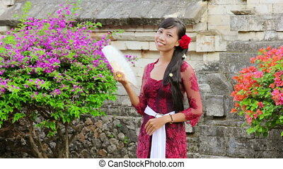 balinese girl in uluwatu temple