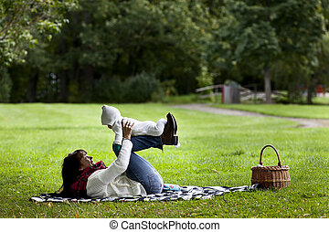 Love - Mother and daughter together Lying in park