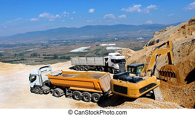 excavator and truck in the stone mine