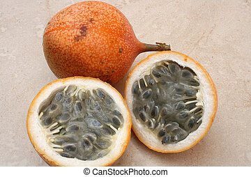 Granadilla fruit has a hard outer shell and a soft grey pulp...