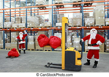 santa clauses in storehouse - two santa clauses workers at...