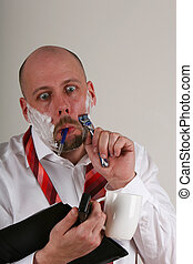 getting desperate - An overworked man doing many things at...