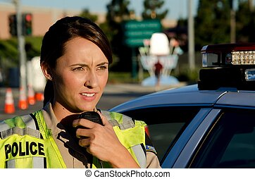 Female police officer - A female police officer talks on her...