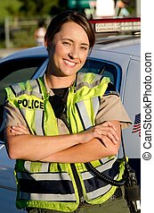 Female police officer - a female police officer smiling as...