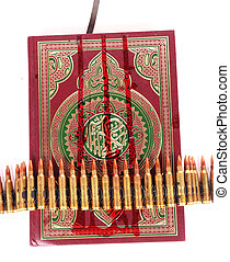Koran and bandoleer - A front of the Koran with a bandoleer...