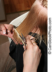 combing wet hair - professional hairdresser cutting childs...
