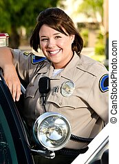 police officer - a friendly looking police officer smiles...