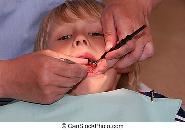 Lets have a look - A young boy at the dentists, dentist...