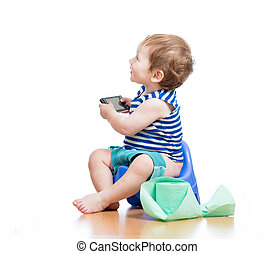 funny baby sitting on chamber pot with pda and toilet paper...