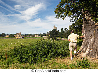 Church St James across meadow in Chipping Campden - Man...
