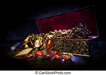 Treasure box - Silver treasure box in the dark, full of...
