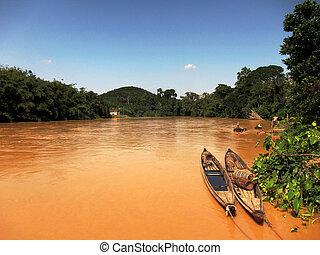 Boats on muddy river, Pahang river, Sundai Pahang, Malaysia