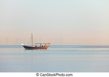 Lone dhow in Qatar - A lone dhow of the shuwai type moored...