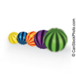 Colorful balls focus - Colorful balls on a row with shallow...