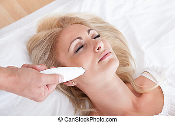 Young Woman During Cosmetic Treatment