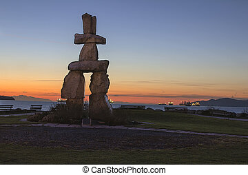 Inukshuk Stone Sculpture Sunset Beach Vancouver BC at Sunset...
