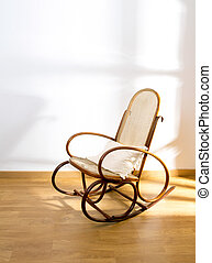Golden retro rocker wooden swing chair on wood floor as a...