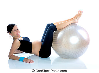 Beautiful pregnant woman at fitness gym with on aerobics...