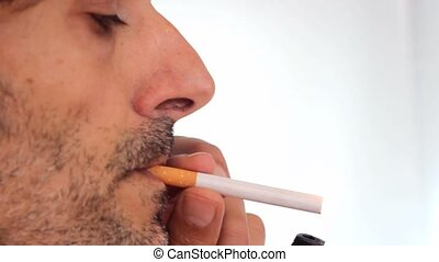 man smoking - unshaven man smoking cigarette
