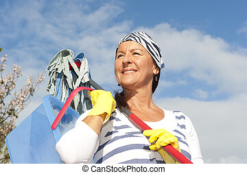 Spring cleaning woman outdoor - Portrait mature cleaning...