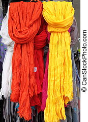 Hanging scarves - Colorful scarves hanging in a shelf of a...