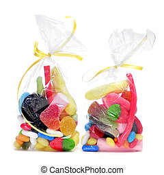 candies - some plastic bags with candies on a white...