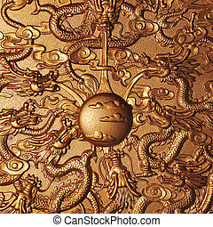 Gold dragon around the gold marble