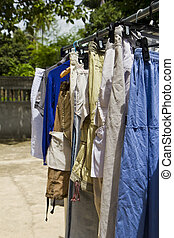Clothes line. - Shirts and pants hanging on a clothes line.