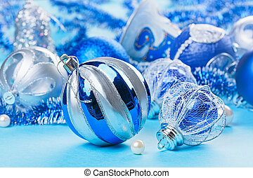 Christmas decoration balls on blue background, closeup