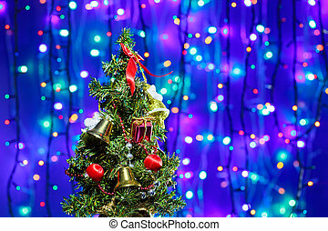 Decorated Christmas tree on multicolor bokeh background