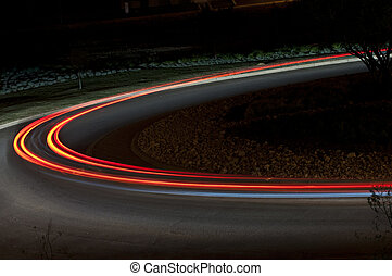Car Tail Lights - The tail lights of a moving Car