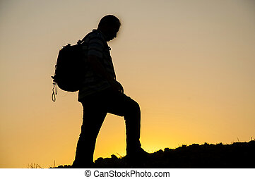 man silhouette on sunset - sunset backpack walking human