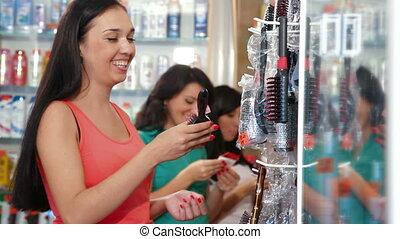 Women Shopping Cosmetics - Shopping women choosing cosmetics...
