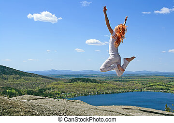 Jumping to the sun - Red-haired girl jumping to the sun on...