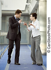 Business together - Businessman and businesswoman walking...