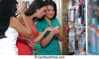 Women Shopping Cosmetics - Young Women Shopping in Cosmetics...