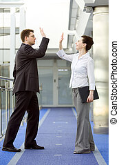 Business together - Businessman and businesswoman...