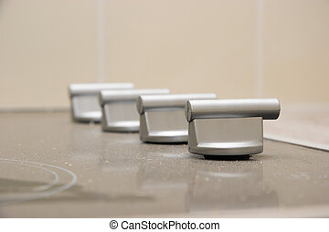 Renovation - Ceramic Stovetop - The knobs on a ceramic...