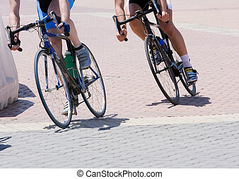 Cyclists - Two cyclists in a race