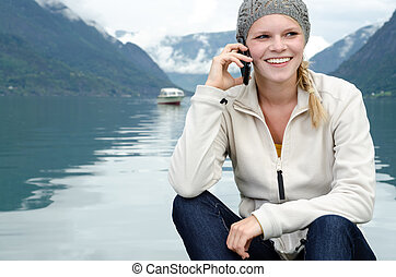 young blond woman called up with her Smartphone