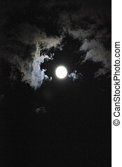 Dark sky moon. - Dark forbidding sky with clouds and moon.