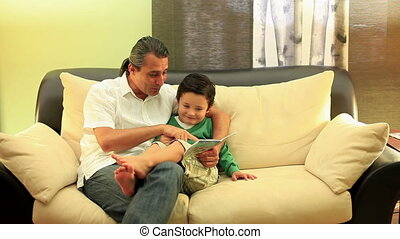 reading a book - father and son reading a book