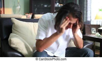 migraine - man has a migraine pain