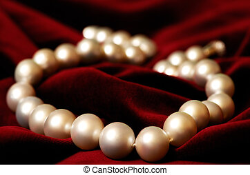 Pearls - Image shows a necklace made out of real pearls on...