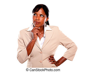 Reflective businesswoman looking to her right on isolated...